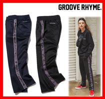 GROOVE RHYME(グルーヴライム) ボトムスその他 【GROOVE RHYME】 JERSEY RUSSELL LOGO TAPE SET TRAINING PANTS