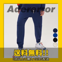 ★ADERerror★ Incision jogger trousers