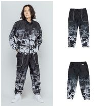 I AM NOT A HUMAN BEING(ヒューマンビーイング) メンズ・ボトムス I AM NOT A HUMAN BEINGのTORN PICTURES TRACK PANTS