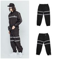 I AM NOT A HUMAN BEING(ヒューマンビーイング) メンズ・ボトムス I AM NOT A HUMAN BEINGの[18FW] IMXHB TRACK PANTS