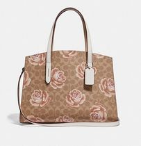 Coach ◆ 31667 Charlie carryall in signature rose print