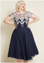 downright dazzling embroidered dress