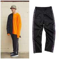 GROOVE RHYMEのJERSEY RUSSELL LOGO TAPE SET TRAINING PANTS