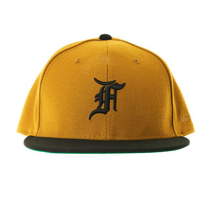 c45725bc836 FEAR OF GOD キャップ  FEAR OF GOD  New Era Fitted Cap   GOLD ...
