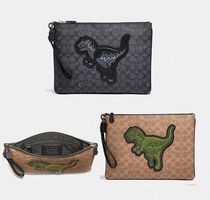 Coach ◆ 67909 Pouch 30 in signature canvas with rexy