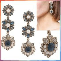 ピアス medium flower embellished earrings