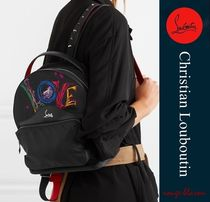studded textured leather-trimmed printed shell backpack