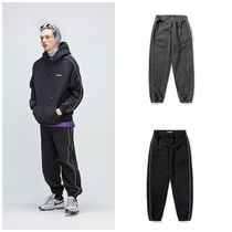 日本未入荷SAINTPAINのSP HILLEND SCOTCH TRACK PANTS 全2色