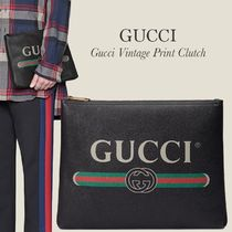 GUCCI vintage print grained leather clutch