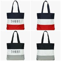 TOMMY JEANSのcotton Square color block logo Canvas bag 全2色