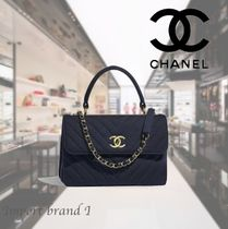 【CHANEL】Small flap bag with handle Jersey  gold metal navy