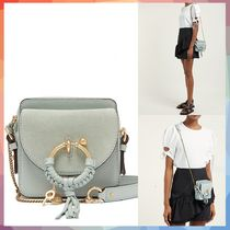 Joan square leather and suede cross-body bag