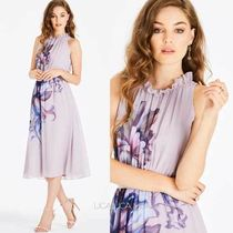 Little Mistress(リトルミストレス) ワンピース 国内発送Little Mistress Floral Placement Midi Dress