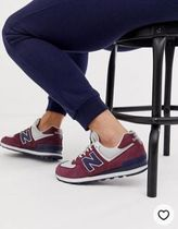 New Balance 574 trainers in burgundy