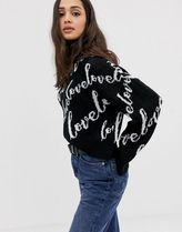 ASOS DESIGN crop jumper with all over love logo