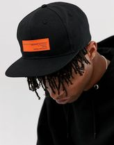 ASOS DESIGN snapback cap in black with neon badge detail