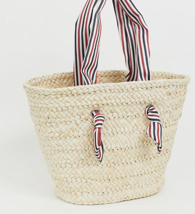 straw beach bag with striped handle
