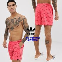 adidas printed swim shorts in red♪