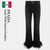 Prada jeans with ostrich feathers