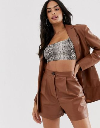 ASOS DESIGN leather look suit shorts in tan