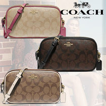 ☆COACH☆クロスボディポーチ In Signature Canvas ☆税・送込