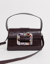ASOS DESIGN shiny croc cross body bag with statement marble