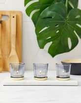 River Island grey glass candle votives on white marble bas