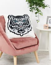 River Island faux fur cushion with tiger print in white