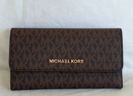【1-2日到着】MICHAEL KORS●JET SET TRAVEL LG TRIFOLD●茶色