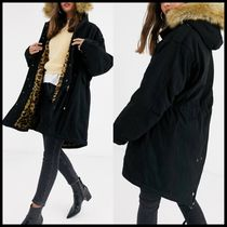 ASOS DESIGN luxe parka with faux fur animal lining in black
