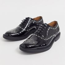 ASOS DESIGN brogue shoes in black patent faux leather
