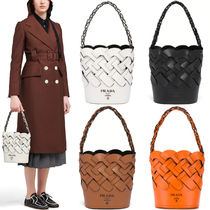 PR2354 BUCKET BAG WITH LARGE WOVEN MOTIF