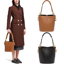 PR2355 LEATHER BUCKET BAG WITH CORD DETAIL