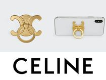 【CELINE】TRIOMPHE PHONE RING IN BRASS★iPhoneアクセサリー