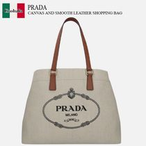 PRADA CANVAS AND SMOOTH LEATHER SHOPPING BAG