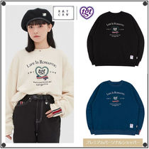 ROMANTIC CROWNの[TGT X RMTCRW]HEART RAUREL SWEAT SHIRT 全3色