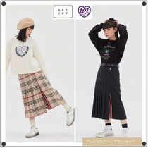 ROMANTIC CROWNの[TGT X RMTCRW]LONG PLEATS SKIRT 全2色