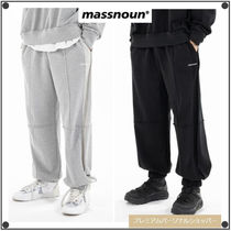 MASSNOUNのREVERSE TRAINING PANTS 全2色