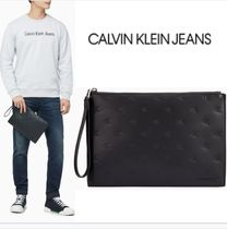 CALVIN KLEIN JEANS エンボス モノグラム クラッチバッグ BLACK