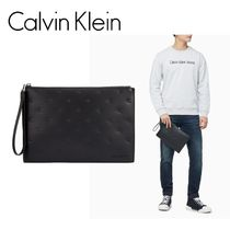 ☆Calvin Klein Jeans☆ エンボス モノグラム クラッチバッグ