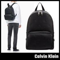 【Calvin Klein JEANS】エンボス モノグラム バックパック