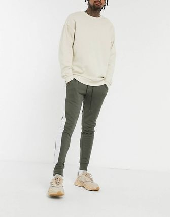 ASOS パンツ ASOS DESIGN skinny joggers with side stripe(13)