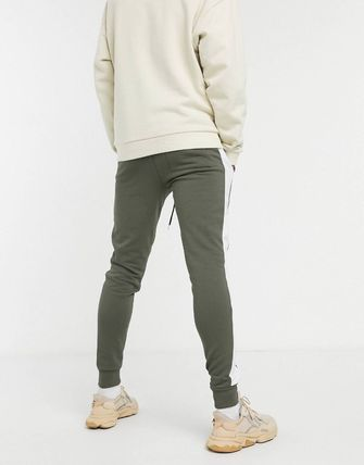 ASOS パンツ ASOS DESIGN skinny joggers with side stripe(11)