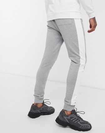 ASOS パンツ ASOS DESIGN skinny joggers with side stripe(7)
