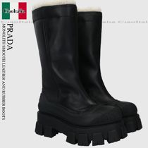 PRADA MONOLITH SMOOTH LEATHER AND RUBBER BOOTS
