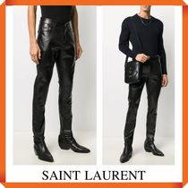 SAINT LAURENT SKINNY JEANS IN OILY COATED STRETCH DENIM