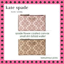 新作*spade flower coated canvas small slim bifold wallet