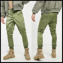 ASOS DESIGN skinny fit trousers in green with MA1 pocket