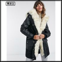 River Island faux leather quilted parka coat in black