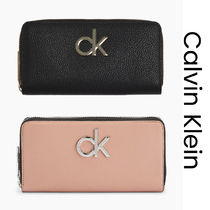 UK発★CALVIN KLEIN 'LARGE ZIP AROUND WALLET' CKロゴ入り
